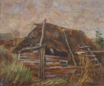 Neglected bath-house with a thatch roof. Chernyy Alexandr
