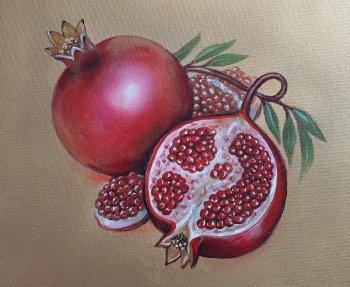 Ripe pomegranate on a gold background