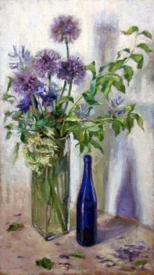 Bouquet with blue bottle