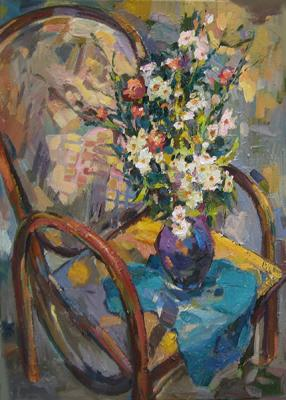 Wildflowers on a wicker chair