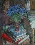 Still life with blue cornflower