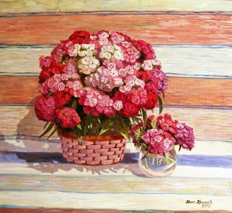 Krasnova Nina. Turkish carnation on background Russian rug